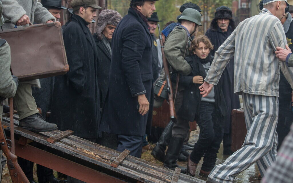 Young Joshua (August Maturo) in moment he spots his dog 'Caleb' (now a Nazi guard dog named 'Blitz') upon his arrival at concentration camp in 'Shepherd: The Story of a Jewish Dog' (JDog Films)
