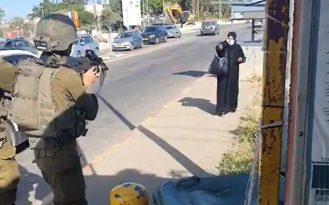 A Palestinian woman (R) approaching IDF soldiers at the Gush Etzion Junction in the West Bank, in an alleged attempt at a stabbing attack, May 2 2021. (screenshot: Twitter)