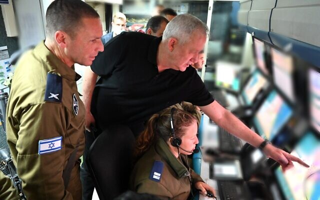 Defense Minister Benny Gantz speaks to an air defense soldier operating an Iron Dome missile defense battery in southern Israel on May 11, 2021. (Ariel Hermoni/Defense Minister)