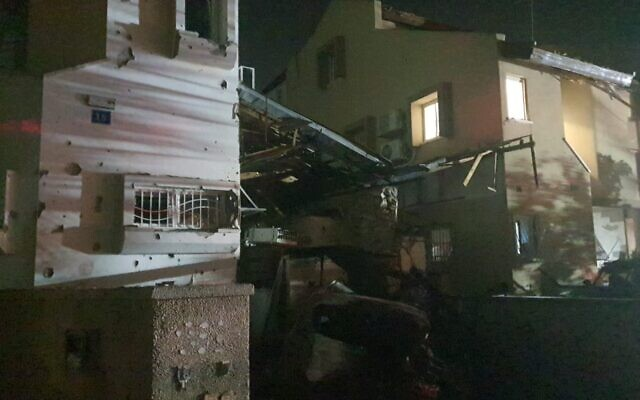 A house that was hit by shrapnel from a rocket strike in the city of Rishon Lezion in central Israel, which also killed a woman, on May 11, 2021. (Israel Police)