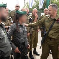 IDF Chief fo Staff Aviv Kohavi, right, meets with Border Police officers who responded to a shooting attack in the West Bank two days prior, on May 9, 2021. (Israel Defense Forces)