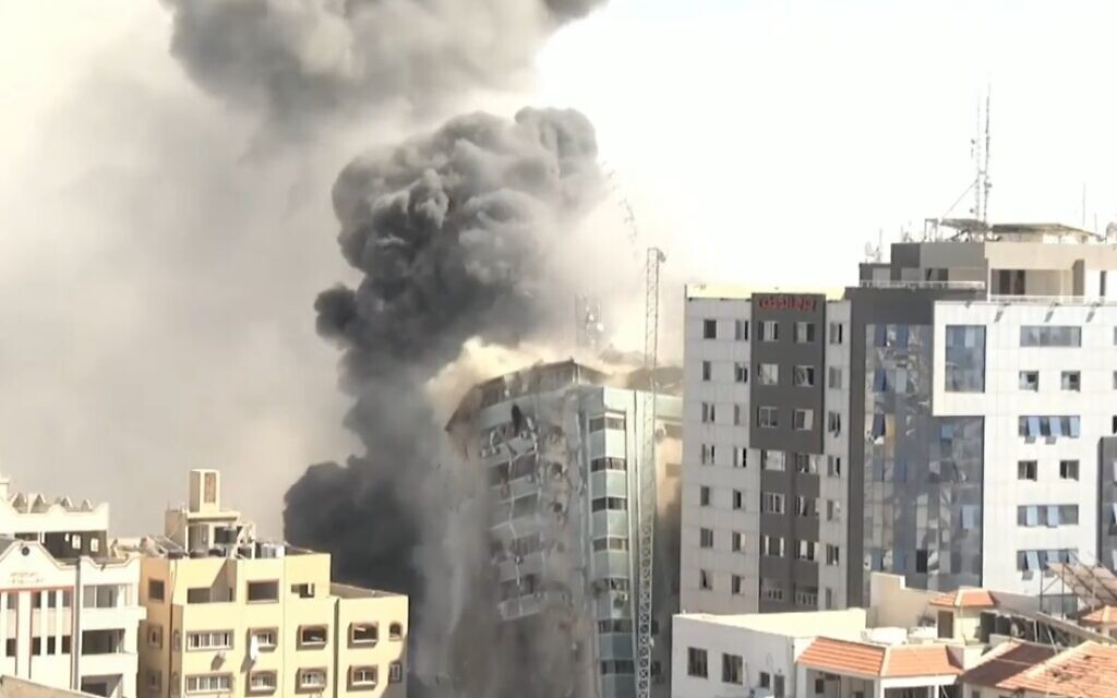 Gaza's Jalaa Tower, which housed the offices of the Associated Press and Al Jazeera, is destroyed in Israeli strikes after occupants were warned to depart, May 15, 2021 (video screenshot)