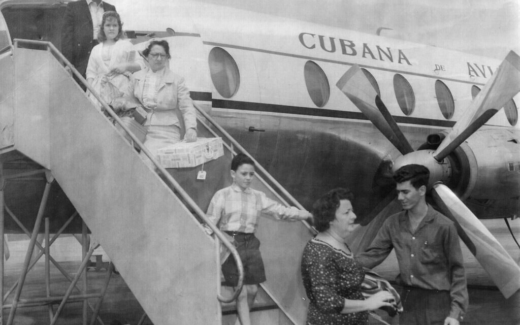 Ruth Behar's grandmother (carrying box) emigrating from Cuba to the US in 1961. (Courtesy)