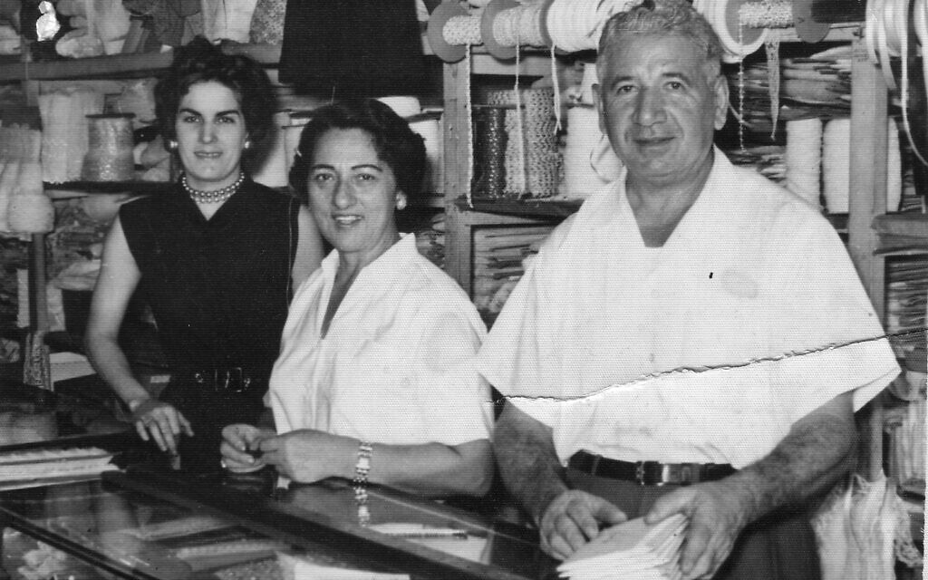 Ruth Behar's grandmother Esther and grandfather Maximo (center and right) at their lace store in Havana, with an employee, early 1950s. (Courtesy)