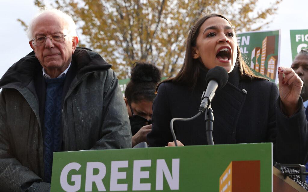 Democratic presidential candidate Sen. Bernie Sanders and Rep. Alexandria Ocasio-Cortez hold a news conference in Washington, DC, November 14, 2019. (Chip Somodevilla/Getty Images via JTA)