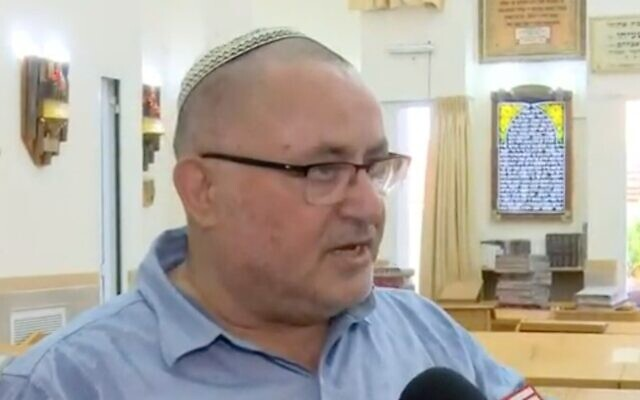 Shalom Biton, cantor of the Yad Michael synagogue in Ashkelon, speaks as the synagogue is cleaned up following a rocket attack from the Gaza Strip, on May 16, 2021. (Channel 12 screenshot)