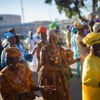 Members of the Hebrew Israelites Community of Dimona dance during festivities marking the Shavuot festival in the southern Israeli town of Dimona, May 26, 2013. (Yonatan Sindel/Flash90/File)
