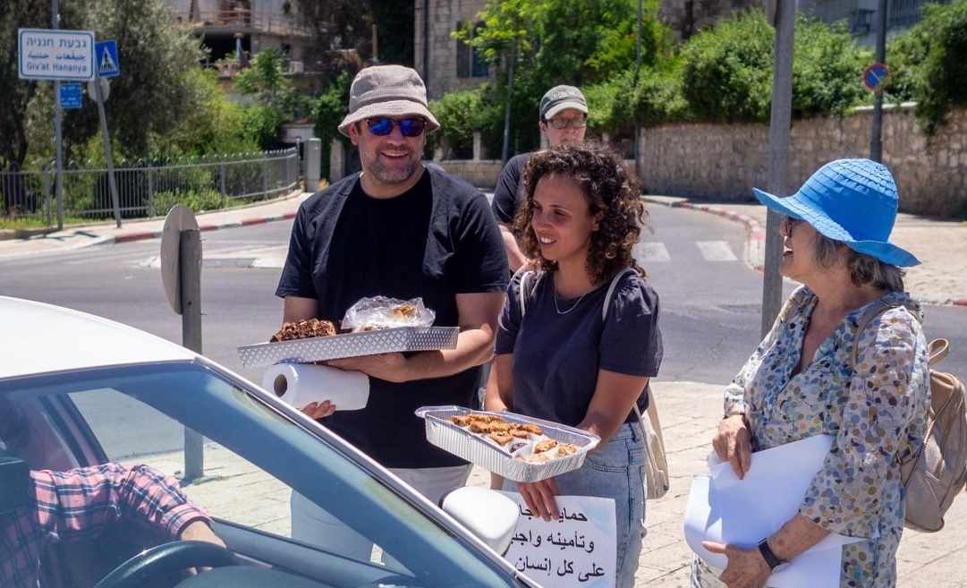 In the spirit of coexistence, Jewish residents of Abu Tor, Jerusalem, hand out cake, sweets and good wishes to their Arab neighbors during the Muslim holiday of Eid al-Fitr at the end of Ramadan, May 15, 2021 (Good Neighbors).