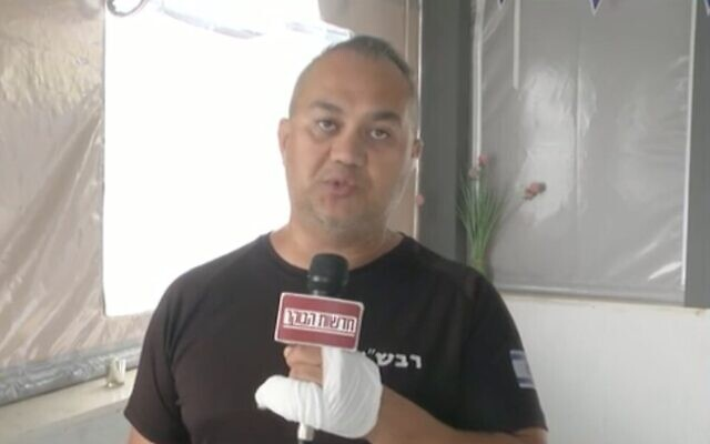 Screen capture from video of community security officer Andrei Dustov describing how he fought hand to hand with a knife-wielding terrorist from the Gaza Strip, May 31, 2021. (Channel 12 News)