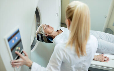 A woman undergoing CT scan as part of cancer screening (Drazen Zigic via iStock by Getty Images)