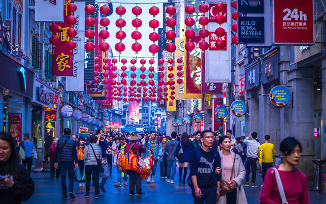 Guangzhou, China, December 2019. The Shangxiajiu pedestrian street in Liwan District, a main shopping district of the city and a major tourist attraction (Parichart Thongmee; iStock by Getty Images).