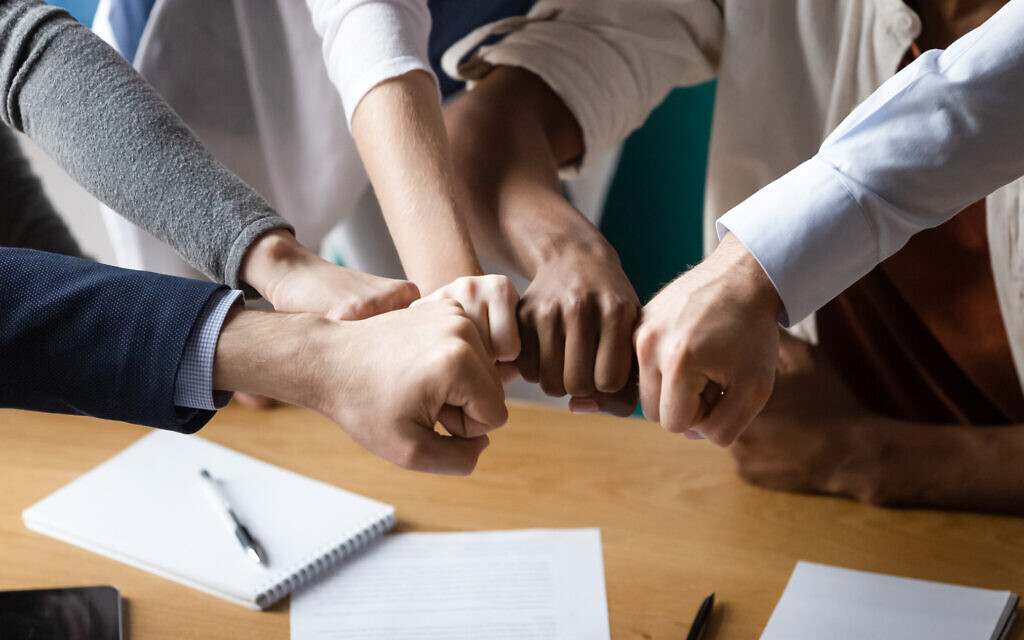An illustrative image of solidarity at the workplace (fizkes; iStock at Getty Images)
