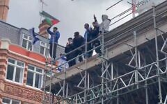 Israeli flags are ripped up and thrown from a building during a protest in London, May 15, 2021 (Screen grab/Twitter)