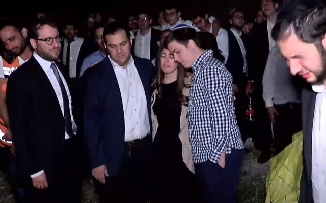 The parents of Donny Morris, killed in the Meron disaster, attend his funeral in Jerusalem, May 2, 2021 (Screen grab)