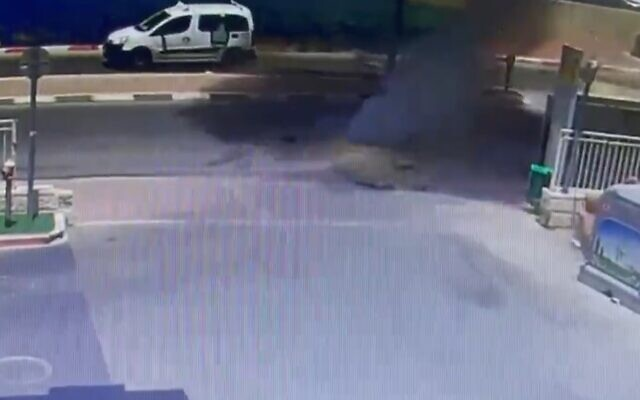 The moment a rocket slammed into the road outside a gas station in Netivot, May 16, 2021 (Screen grab/Kann)