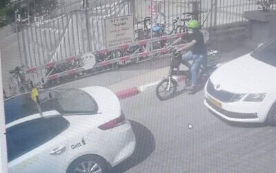 In this image from video released by Israel's Police, a man can be seen on an electric bike carrying his newborn child in a basket, in Tel Aviv, on May 5, 2021. (Israel Police)