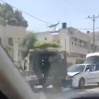 The scene of a car-ramming at Hawara in the West Bank, May 17, 2021 (Screen grab/Kan)