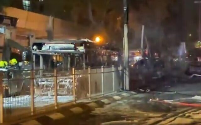 A burnt bus is seen in Holon, south of Tel Aviv, after being hit by a rocket during a massive barrage on central Israel, May 11, 2021 (video screenshot)