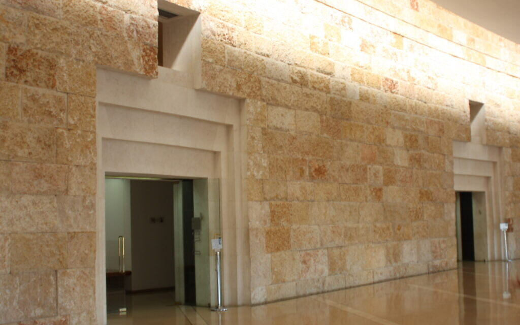 A wall lined with Jerusalem stone at the Supreme Court building in Jerusalem, April 2021. (Shmuel Bar-Am)