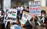 Demonstrators against Israel hold signs at a rally in Vienna, Austria, where protesters chanted in Arabic about a massacre of Jews, May 13, 2021. (Courtesy of Austrian Union of Jewish Students via JTA)