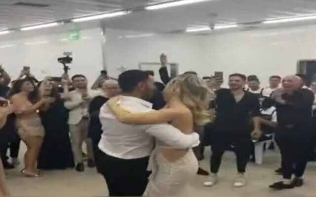 Guests dance in the bomb shelter as Loren and David's wedding is interrupted by rocket fire, May 19, 2021 (Screen grab, Channel 12)