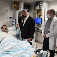 Prime Minister Benjamin Netanyahu visits a man injured in the Mount Meron disaster, at Haifa's Rambam Medical Center, May 2, 2021. (Courtesy)