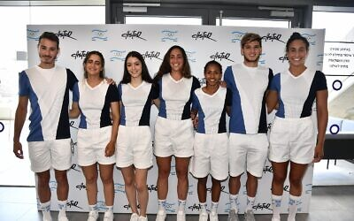 Seven of Israel's athletes for the upcoming Tokyo Olympic games model the T-shirts and shorts that are part of their official uniforms. (Amit Schussel/IOC)