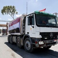 A convoy of trucks loaded with construction equipment provided by Egypt arrives at the Palestinian side of the Rafah border crossing between Egypt and the Hamas-ruled Gaza Strip, on June 4, 2021. (Said Khatib/AFP)