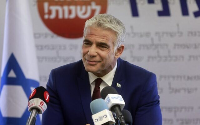 Yesh Atid leader Yair Lapid gives a statement at his party's faction meeting in the Knesset, June 7, 2021 (Menahem Kahana / AFP)