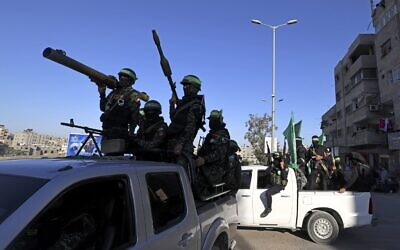 Members of the armed wing of Hamas parade in Gaza City on June 7, 2021. (MOHAMMED ABED/AFP)