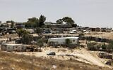 This picture taken on June 8, 2021 shows a view of houses in the unrecognized Bedouin village of Sawaneen in Israel's southern Negev Desert. (HAZEM BADER / AFP)