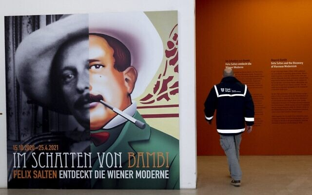A man passes by a poster of Felix Salten (L) as he enters the exhibition 'Beyond Bambi - Felix Salten and the Discovery of Viennese Modernism,' at the Wien Museum in Vienna, Austria, on March 23, 2021. (Joe Klamar/AFP)