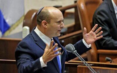 Prime Minister-designate Naftali Bennett addresses the Knesset, June 13, 2021. (EMMANUEL DUNAND / AFP)