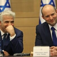 Prime Minister Naftali Bennett (R) and Alternate Prime Minister and Foreign Minister Yair Lapid at the new government's first cabinet meeting, held at the Knesset on June 13, 2021. (Gil COHEN-MAGEN / AFP)