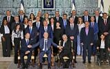 Ministers in the newly sworn-in Israeli government pose for the traditional group photo at the President's Residence in Jerusalem on June 14, 2021. (Emmanuel Dunand / AFP)