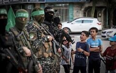Palestinian boys queue to register for a summer camp organised by the Hamas military wing, Ezz-Al Din Al-Qassam Brigades in Gaza City on June 14, 2021. (Photo by MAHMUD HAMS / AFP)