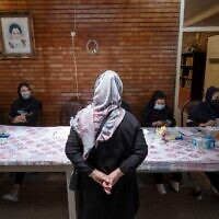An Iranian Christian woman waits to register before voting at a polling station located in a school for Tehran's minority Christian community, on the day of the Islamic republic's presidential election on June 18, 2021. (MORTEZA NIKOUBAZL / AFP)