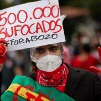 A demonstrator protests against Brazilian President Jair Bolsonaro's handling of the COVID-19 pandemic in Manaus, Brazil on June 19, 2021. - Brazil has passed the milestone of 500,000 COVID-19 victims. (Michael Dantas / AFP)