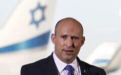 Prime Minister Naftali Bennett delivers televised remarks at Ben Gurion Airport, on June 22, 2021. (Jack Guez/AFP)