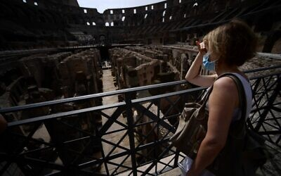 A visitor looks at the underground area inside the Colosseum in Rome on June 25, 2021 (Filippo MONTEFORTE / AFP)