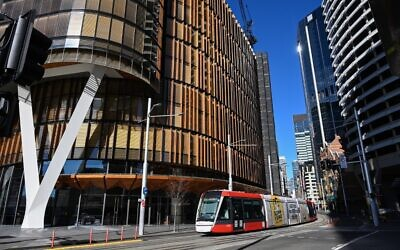 A tram commutes on a street in Sydney on June 26, 2021, after authorities locked down several central areas of Australia's largest city to contain an outbreak of the highly contagious Delta variant. (SAEED KHAN / AFP)