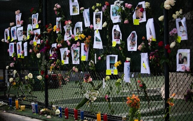 Photos of missing residents are posted at a makeshift memorial at the site of a collapsed building in Surfside, Florida, north of Miami Beach,on June 26, 2021. (Andrea SARCOS / AFP)