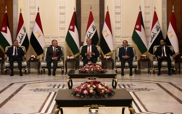 Iraqi President Barham Saleh (C), Prime Minister Mustafa Al-Kazemi (L) and Parliament Speaker Muhammad Al-Halbousi (R) receive Egypt's President Abdel Fattah al-Sisi (2-R), and Jordan's King Abdullah II (2-L), in the capital Baghdad on June 27, 2021, in the first visit by an Egyptian head of state to Baghdad in three decades. (AHMAD AL-RUBAYE/AFP)