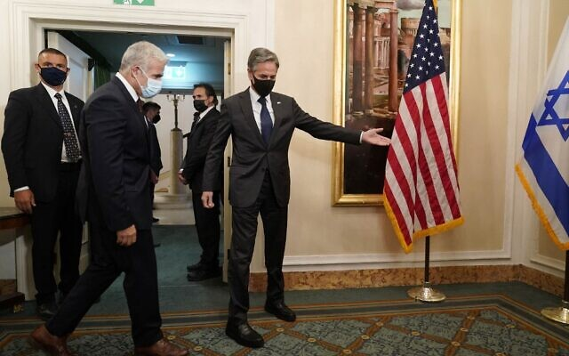 US Secretary of State Antony Blinken (right) welcomes Foreign Minister Yair Lapid ahead of their meeting in Rome, on June 27, 2021. (Andrew Harnik/Pool/AFP)