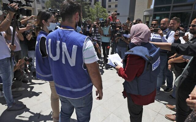 Journalists protest outside the United Nations office in the West Bank city of Ramallah on June 28, 2021, demanding protection following attacks by Palestinian Authority security forces on their colleagues. (Photo by ABBAS MOMANI / AFP)