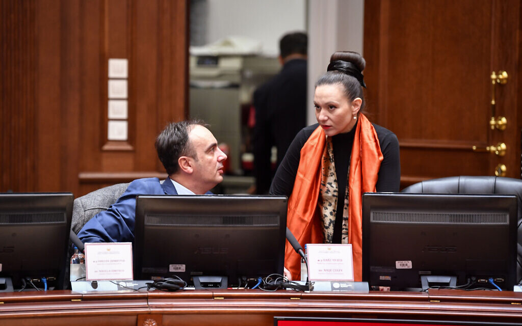 Rasela Mizrahi, right, speaks to a colleague during a cabinet meeting in Skopje, North Macedonia, January 14, 2020. (Courtesy of the Parliament of North Macedonia/ via JTA)