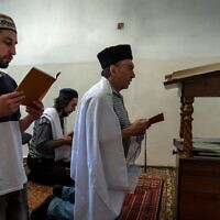 Crimean Karaites attend a religious service in a room outside their house of worship in Simferopol, Crimea, June 9, 2018. (Sergei Malgavko/TASS via Getty Images via JTA)