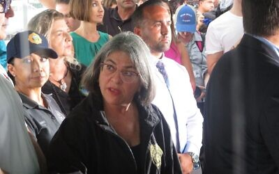 Miami-Dade County Mayor Daniella Levine Cava consults with aides during a news conference at the site of the building collapse in Surfside, Florida, June 28, 2021. (Ron Kampeas/JTA)