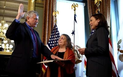 Eric Lander, the incoming director of the White House Office of Science and Technology Policy, participates in a swearing-in ceremony with US Vice President Kamala Harris in her ceremonial office, as his wife Lori Lander holds a 13-page fragment of a Pirkei Avot text from 1492 in the Eisenhower Executive Office Building on June 2, 2021 in Washington, DC. (Anna Moneymaker/Getty Images/AFP)