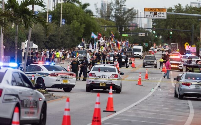 Police investigate the scene where a pickup truck drove into a crowd of people at a Pride parade on June 19, 2021 in Wilton Manors, Florida. (Jason Koerner/Getty Images/AFP)